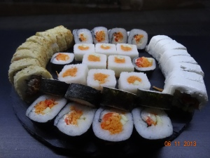several types of sushi: breaded, with nori (seaweed), w/o nori, cream-cheese covered...