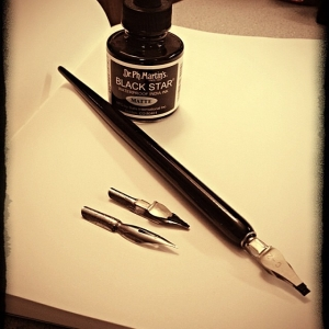calligraphy pen, metal nibs, an ink pot, and a moleskine notebook!