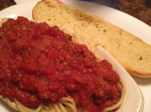 meat sauce pasta side with garlic bread