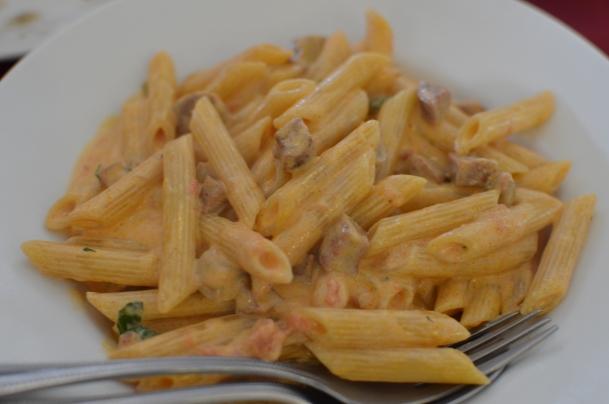 Javier's Penne con Salsiccie: Italian garlic sausage, mushrooms, tomatoes & cream