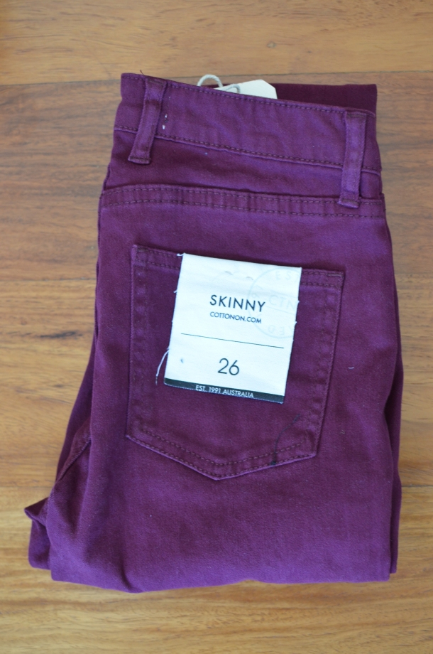 1 pair of dark red jeans