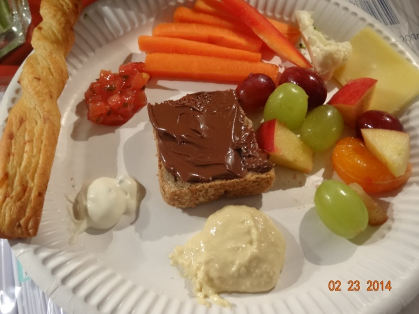 my first plate! hummus with vegetables, fruit salad, cheese breadstick with salsa, and nutella on toast