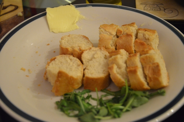 sliced (toasted) bread with butter and salad rocket