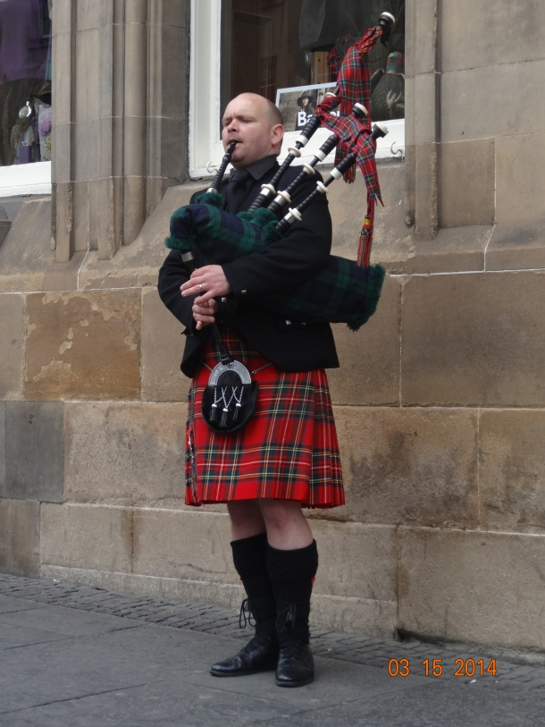 authentic Scottish bagpipe player