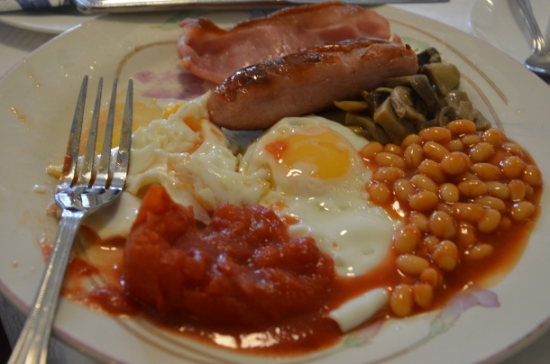 full English breakfast: eggs, mushrooms, tomatoes, beans, bacon, sausages